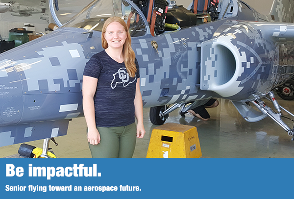 Amber Bishop standing in front of a military trainer jet.